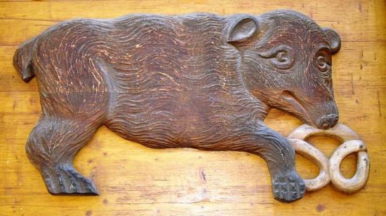 Ours tenant un bretzel, emblème des pains d'épiciers au Moyen âge.