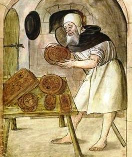 La fabrication du pain d'épice dans un monastère à l'aide de moules en bois gravés, dessin de 1520.