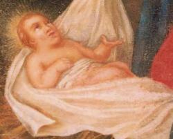 Au centre l'Enfant-Jésus dans son rayonnement de gloire